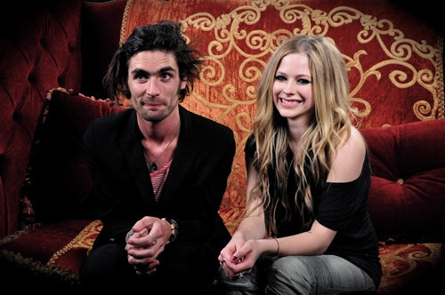 Avril Lavigne Sitting With Tyson Ritter