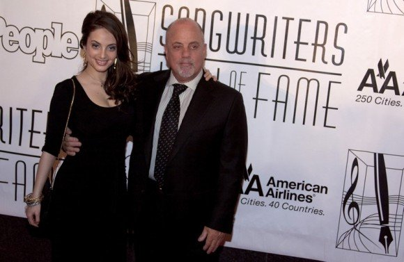 BillyJoel Posing For the Camera WithFemale