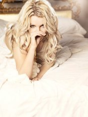 Britney Spears Laying On a Bed
