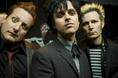 Green Day Band In Suits Staring At the Camera