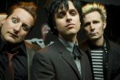 Green Day In Suits Staring at Camera